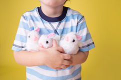 Child playing with Easter Bunny Toys Royalty Free Stock Photo