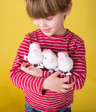 Child playing with Easter Bunny Toys Stock Image