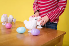 Child playing with Easter Bunny Toys Stock Photography