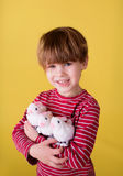 Child playing with Easter Bunny Toys Stock Photos