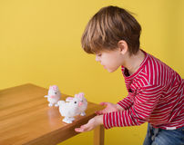 Child playing with Easter Bunny Toys Stock Images