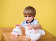 Child playing with Easter Bunny Toys Royalty Free Stock Photography