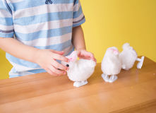 Child playing with Easter Bunny Toys Royalty Free Stock Photos