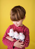 Child playing with Easter Bunny Toys Stock Photo
