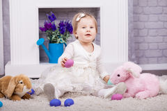 Child playing with Easter eggs Royalty Free Stock Photography