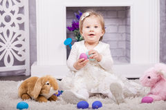 Child playing with Easter eggs Stock Photos