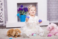 Child playing with Easter eggs Royalty Free Stock Image
