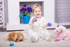 Child playing with Easter eggs Stock Photo