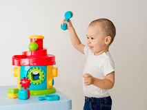 Child playing with educational cup toys. Stock Photo