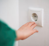 Child playing with electrical socket. Stock Photo