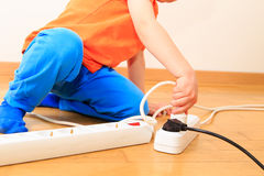Child playing with electricity. Kids safety concept Stock Photos