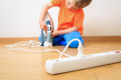 Child playing with electricity, kids safety Stock Photography