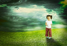 The child playing in the field Royalty Free Stock Photos