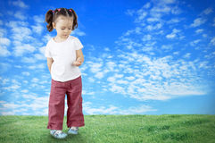 The child playing in the field Royalty Free Stock Photo