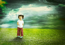 The child playing in the field Stock Photo