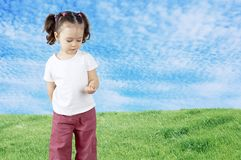 The child playing in the field Stock Images