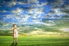 The child playing in the field Royalty Free Stock Images