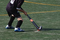 Child playing field hockey stock photography