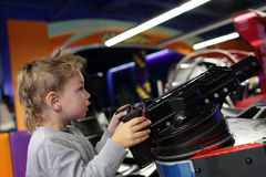Child playing a first person shooter Stock Photos