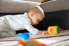 Child playing on floor Stock Photography