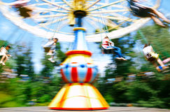 Child playing flying swing in park Stock Photo