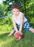 Child playing football Stock Image