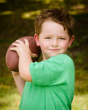 Child playing with football outdoors Royalty Free Stock Images