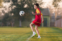 Child playing football Royalty Free Stock Photo