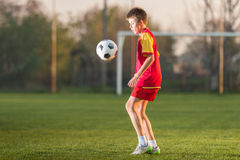 Child playing football Royalty Free Stock Photos