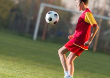 Child playing football Royalty Free Stock Photography