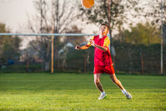 Child playing football. On a soccer field Stock Photography