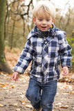 Child playing in forest Stock Image