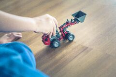 Child Playing Front Loader Toy Stock Images