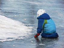 Child playing on frozen lake Stock Photos