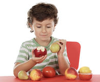 Child playing with fruits Stock Photo