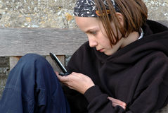 Child playing game on mobile phone. Nikon d70, portrait of child Royalty Free Stock Photos