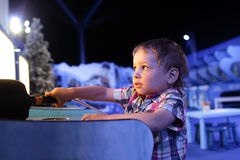 Child playing in the games attraction Stock Photo