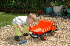 Child playing in garden. Stock Photo