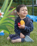 Child playing in garden in nursery Stock Photo