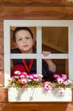 Child playing in garden shed Stock Photo