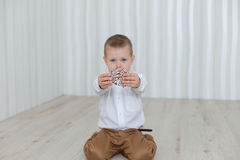 Child playing with gingerbread New Year`s Eve Royalty Free Stock Photo