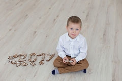 Child playing with gingerbread New Year`s Eve Stock Images