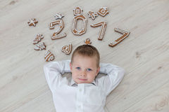 Child playing with gingerbread New Year`s Eve Royalty Free Stock Photos