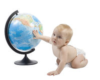 Child playing with globe. Little baby play with terrestrial globe and learn it, his hand is on pacific ocean . Isolated on white Royalty Free Stock Images