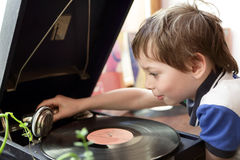 Child playing with gramophone stock photos
