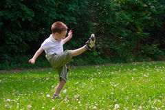 Child playing on grass Royalty Free Stock Photos