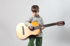 Child playing guitar Stock Photos
