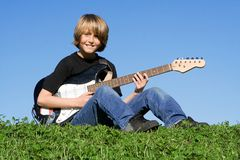 Child playing guitar Royalty Free Stock Photos