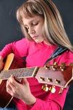 Child playing guitar Stock Photo
