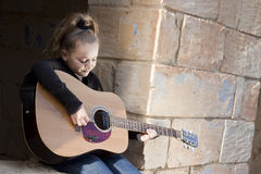 Child playing guitar Royalty Free Stock Images